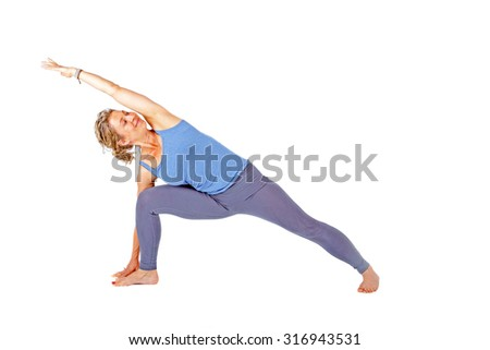 Young woman making a yoga posture on a white background - stock photo