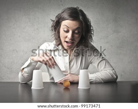 Young woman making conjuring tricks - stock photo