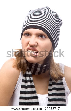 young woman making face on white