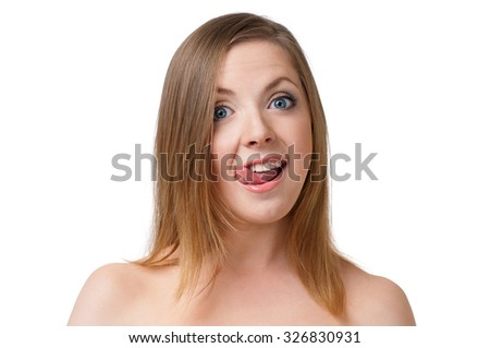 Young woman making faces, isolated on white background - stock photo