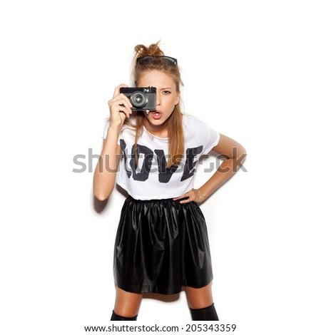 Young woman making photo using noname retro camera. White background, not isolated - stock photo