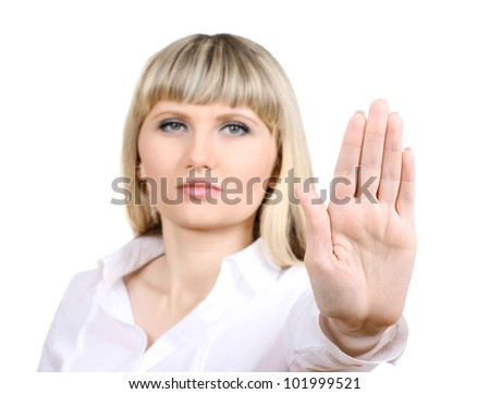 Young woman making stop gesture isolated on white - stock photo