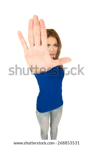 Young woman making stop sign with her hand. - stock photo