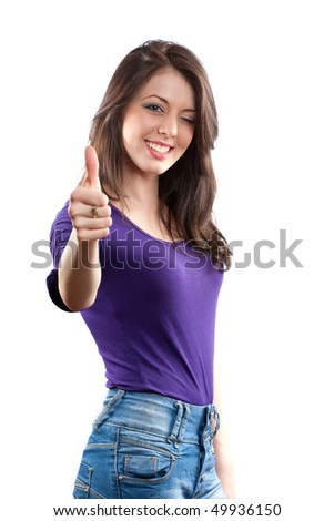 Young woman making thumbs up sign isolated on white