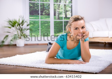 young woman making yoga exercise at home