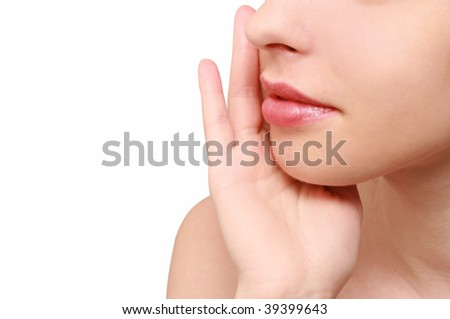 young woman massages the face - stock photo