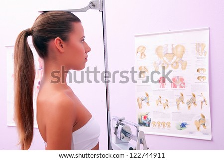 young woman measuring height - stock photo
