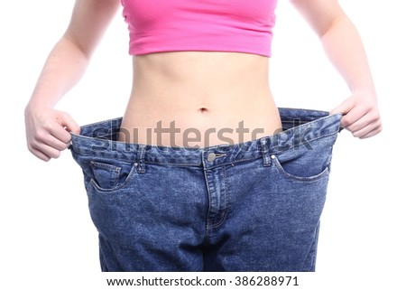 Young Woman Measuring Her Waistline  - stock photo