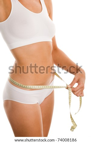 Young woman measuring perfect shape - stock photo