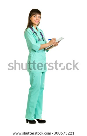 Young woman medical  doctor or nurse writing something in notebook with copy space for text, isolated on white background in full length. - stock photo