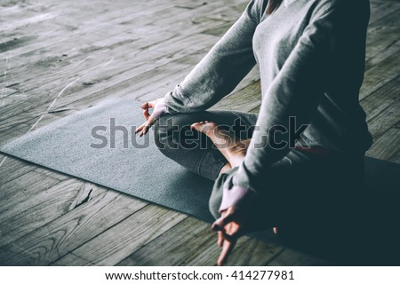 Young woman meditates while practicing yoga. Freedom concept. Calmness and relax, woman happiness. Toned picture - stock photo