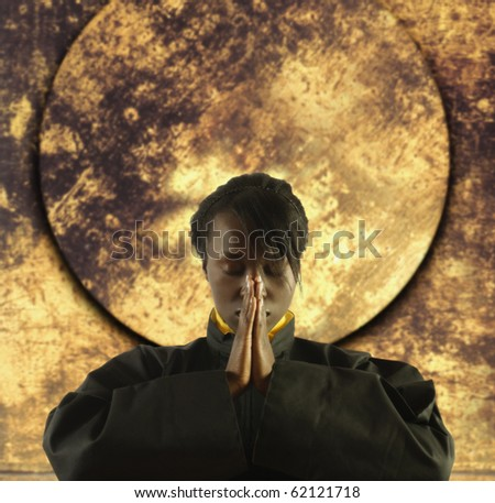 Young woman meditating - stock photo