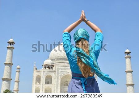 Young woman meditating atTaj Mahal. Agra, India - stock photo