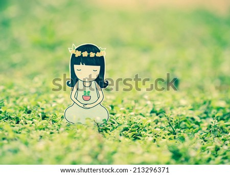 Young woman meditating in nature. - stock photo