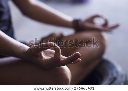 Young woman meditating indoors - stock photo