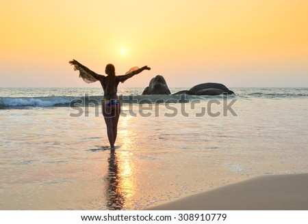 Young woman meditating on Agonda beach. South Goa, India - stock photo