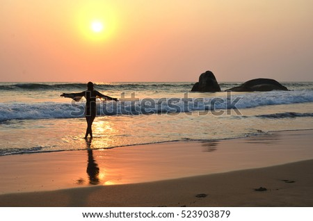 Young woman meditating on Agonda beach. South Goa, India
