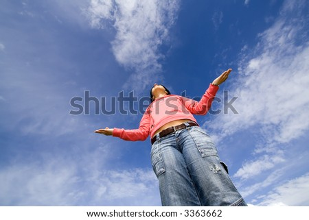 Young woman meditating outdoors in yoga pose - stock photo