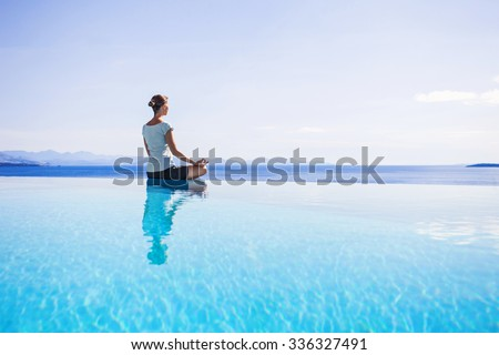 Young woman meditating outdoors. Yoga exercises. Women Yoga. Healthy lifestyle concept - stock photo