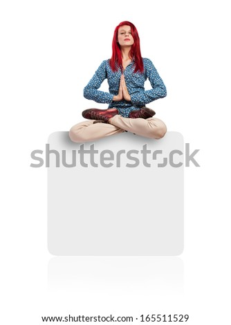 young woman meditating sitting on a box isolated on white background