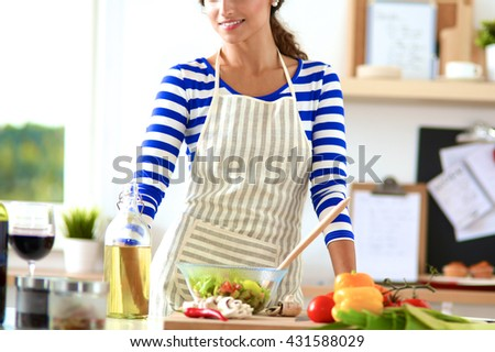 Young woman mixing fresh salad - stock photo