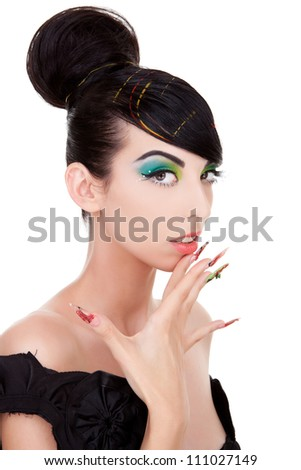 Young woman model with excentric makeup and nails touching her chin . Over white background - stock photo