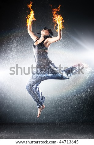 Young woman modern dance. Water studio photo and fire effect. - stock photo
