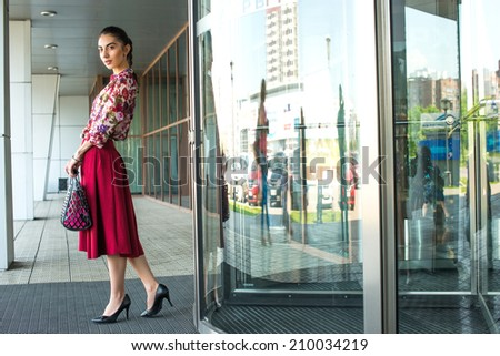 Young woman near a shopping mall