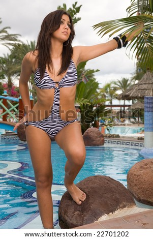 young woman near the swimming pool