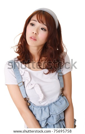 Young woman of Asian with cool expression on face, half length closeup portrait on white background. - stock photo