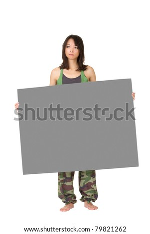 Young woman of fitness holding gray blank board, full length portrait isolated on white background. - stock photo