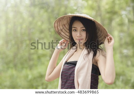Young woman of native dress in forest