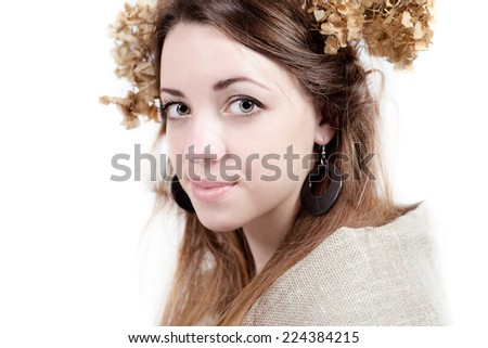 young woman of natural beauty in rural style with flax and dried flowers