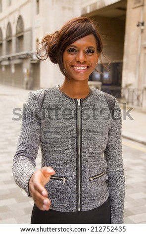 young woman offering a handshake.  - stock photo