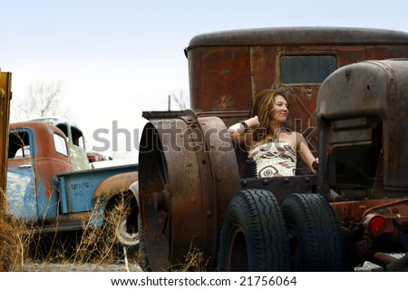 Young Woman, Old Truck - stock photo