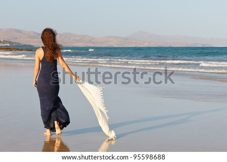 Young woman on a beach - stock photo