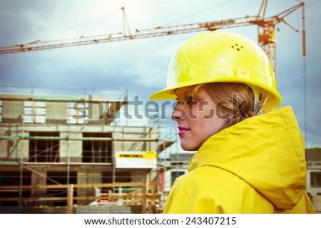 Young woman on a building site - stock photo