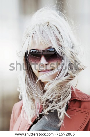 Young woman on a city street - stock photo