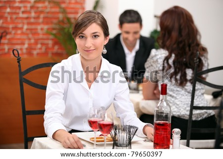 Young woman on a date in a restaurant - stock photo