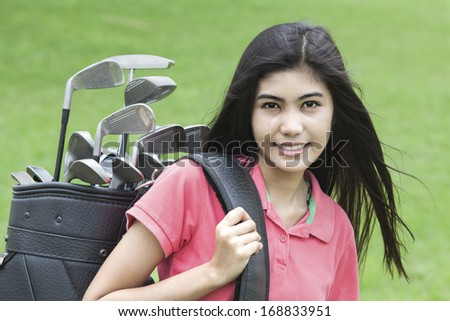 Young woman on a golf course on a sunny autumn day in the green background  - stock photo