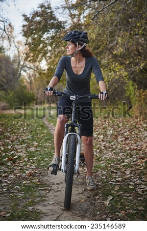 young woman on a mountain bike - stock photo