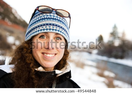 young woman on a mountain in the winter