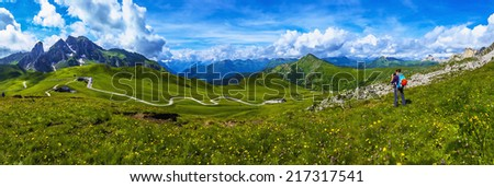 Young woman on a mountain trail, Tofane, Dolomites Mountains, Italy - stock photo