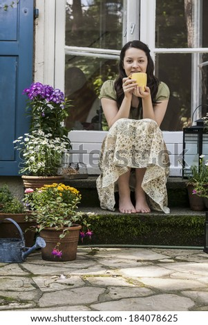 young woman on a patio - stock photo