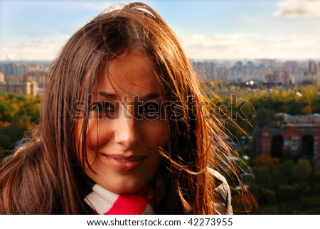 young woman on a roof of a skyscraper