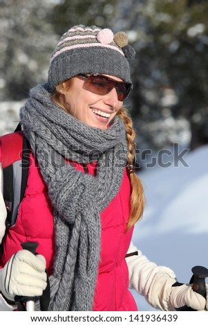 young woman on a ski vacation - stock photo