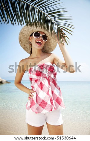 young woman on a tropical bach - stock photo