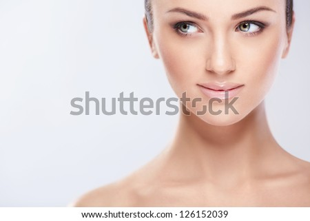Young woman on a white background - stock photo
