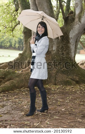 young woman on autumn forest with umbrella
