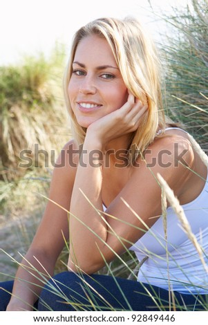 Young woman on beach - stock photo